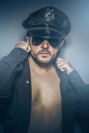 hijacker: Sexy police concept, dangerous man with sunglasses Stock Photo
