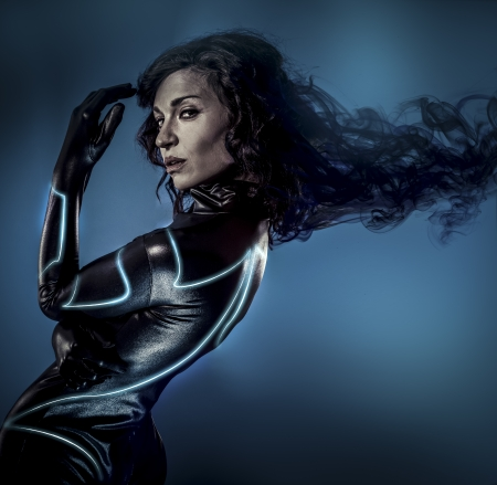 Future women concept, black latex with neon lights photo