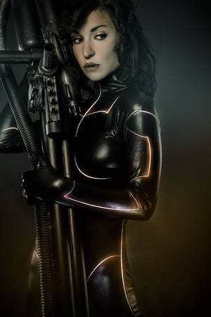Armed, Future women concept, black latex with neon lights photo