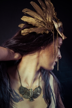 Viking, Warrior woman with gold mask, long hair brunette. Long hair. Profile. Studio shot photo