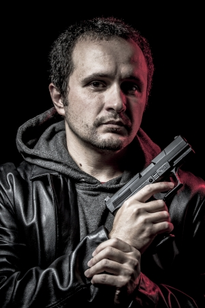 Mafia, thief, armed man with black leather jacket, dangerous Stock Photo - 24771286