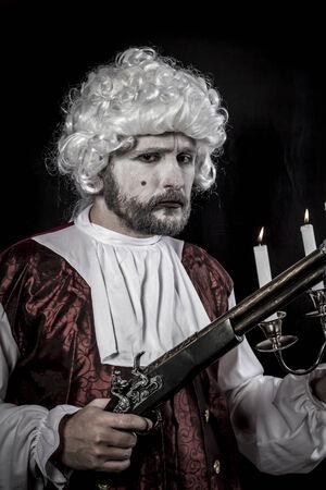 musket: Musket and candle, gentleman rococo era wig Stock Photo