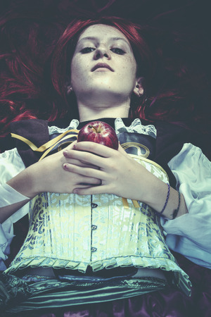 Young drown woman in a poetic representation. Holding an apple, fantasy art photo