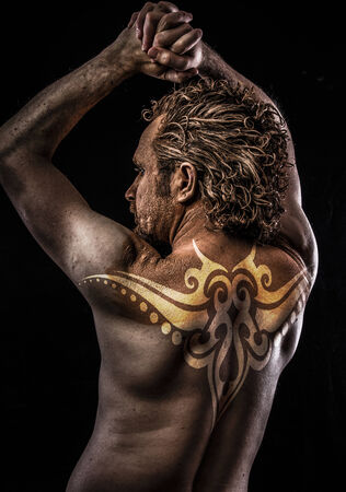 Male model with tribal tattoo, evil, blind, fallen angel of death photo