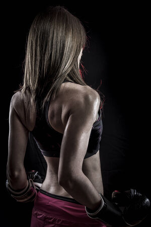 Strength, strong woman athlete with boxing gloves photo