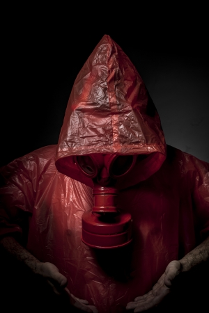 Planet, A man in a gas mask over  the smoke. black background and red colors photo
