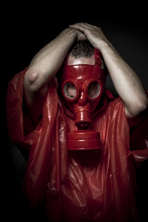 Substance, A man in a gas mask over  the smoke. black background and red colors photo