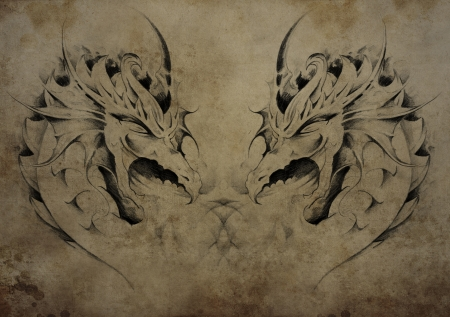 Tattoo dragons over vintage paper, black tribal tattoos photo