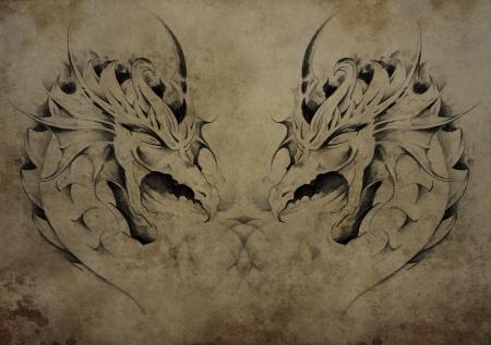 Tattoo dragons over vintage paper, black tribal tattoos photo