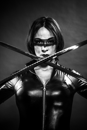 Girl with katana sword. dressed in black latex, comic style photo