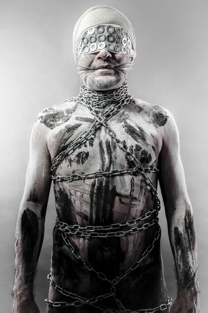 bdsm man. erotic and sensual concept, chains photo