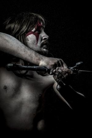 British savage warrior with iron sword photo