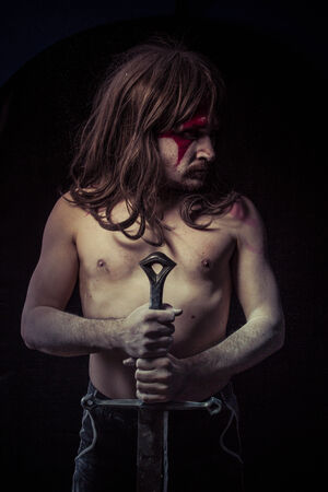 savage warrior with iron sword photo
