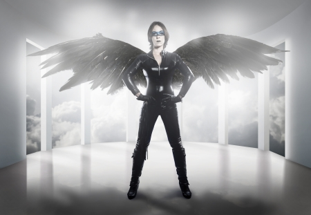 woman dressed in latex, whip and black wings photo