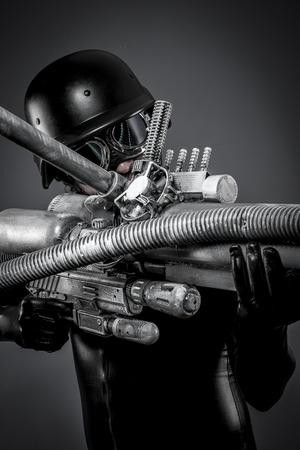 Space.Starfighter with huge plasma rifle, fantasy concept, military helmet and goggles motorcyclist photo