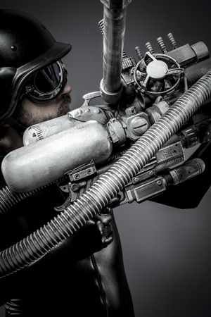 mech: Scifi.Starfighter with huge plasma rifle, fantasy concept, military helmet and goggles motorcyclist