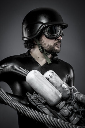 Scifi.Starfighter with huge plasma rifle, fantasy concept, military helmet and goggles motorcyclist photo