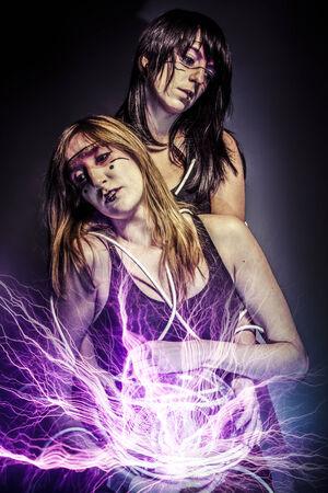 future twin: two women of the future, Twin, future concept, light rays Stock Photo