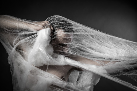 cobwebby: Danger.man tangled in huge white spider web Stock Photo