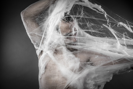 cobwebby: Trap.man tangled in huge white spider web Stock Photo