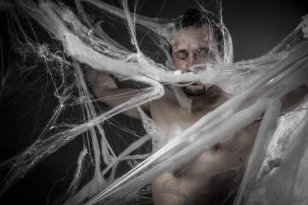cobwebby: Geometry.man tangled in huge white spider web