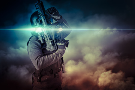 Soldier in uniform with rifle, assault sniper on apocalyptic clouds, firing Stock Photo