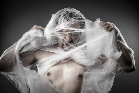 spider man: Danger. man tangled in huge white spider web Stock Photo