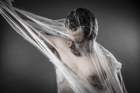 cobwebby: Scary network.man tangled in huge white spider web