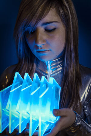 Technology.Fiber Optic concept, woman with modern lights photo