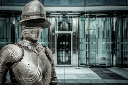 valor: Spam.Medieval armor protecting a business building. Concept of firewall protection