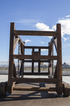 Medieval siege weapons, crossbows, onagers, catapults and battering rams photo