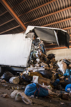 amounts: Recycle plant. truck unloading huge amounts of garbage, recycle plant in spain Editorial