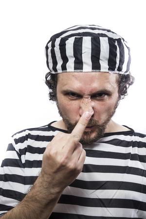 sentenced: Justice, Desperate, portrait of a man prisoner in prison garb, over white background Stock Photo