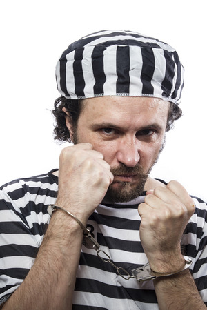 detained: Desperate, portrait of a man prisoner in prison garb, over white background Stock Photo