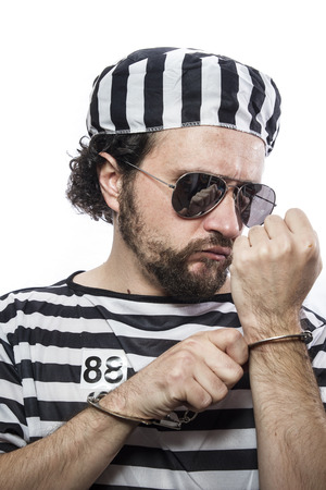 incarcerated: Lawbreaker, Desperate, portrait of a man prisoner in prison garb, over white background