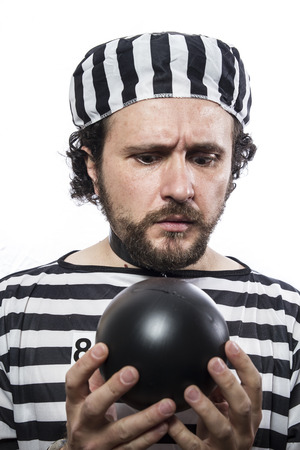 Funny man prisoner criminal with chain ball and handcuffs in studio isolated on white background Stock Photo - 26289108