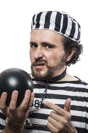 Solution, one caucasian man prisoner criminal with chain ball and handcuffs in studio isolated on white background Stock Photo - 26289110