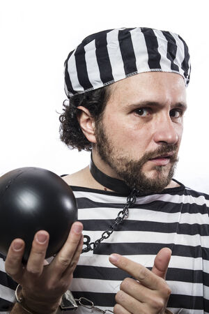 waiting convict: Solution, one caucasian man prisoner criminal with chain ball and handcuffs in studio isolated on white background Stock Photo