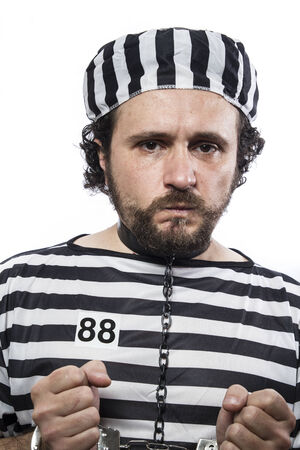 waiting convict: Violence, one caucasian man prisoner criminal with chain ball and handcuffs in studio isolated on white background Stock Photo