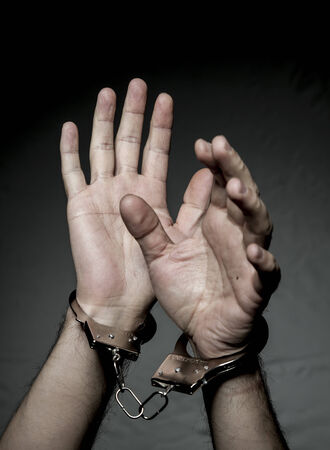 hands with handcuffs. Prison riot concept. Stock Photo