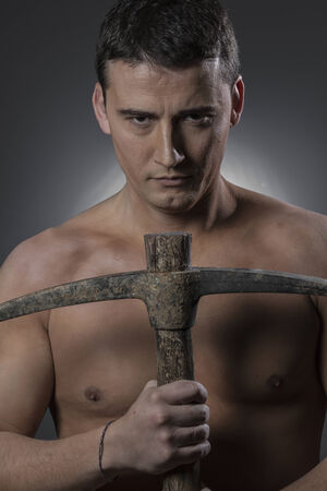 Craftman, Construction worker portrait holding a peak. photo