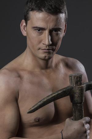 craftman: Repairman, Construction worker portrait holding a peak.