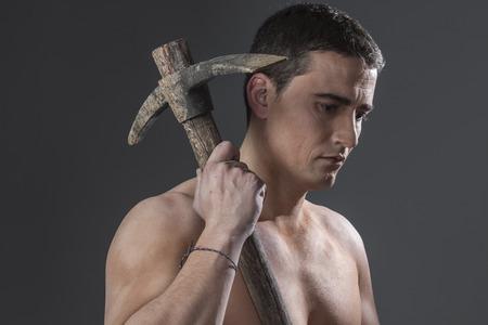 Tool, Construction worker portrait holding a peak. photo