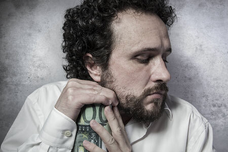 pennypinching: Penny-pinching, stingy businessman, saving money, man in white shirt with funny expressions Stock Photo