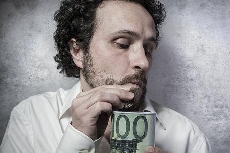 pennypinching: stingy businessman, saving money, man in white shirt with funny expressions