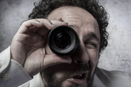 insensitive: Businessman looking through a lens, man in white shirt with funny expressions