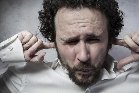 aghast: Businessman covering his ears, man in white shirt with funny expressions