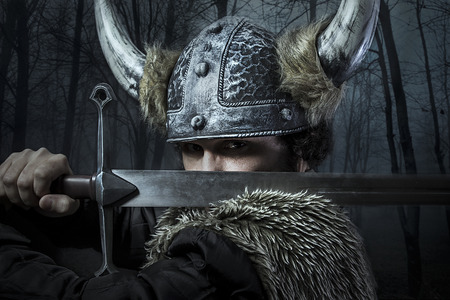 Defense, Viking warrior, male dressed in Barbarian style with sword, bearded