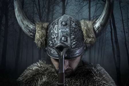 Peace, Viking warrior, male dressed in Barbarian style with sword, bearded Foto de archivo