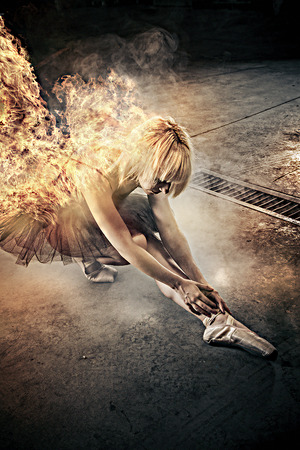 Sexy ballerina dancer with fire in the body photo